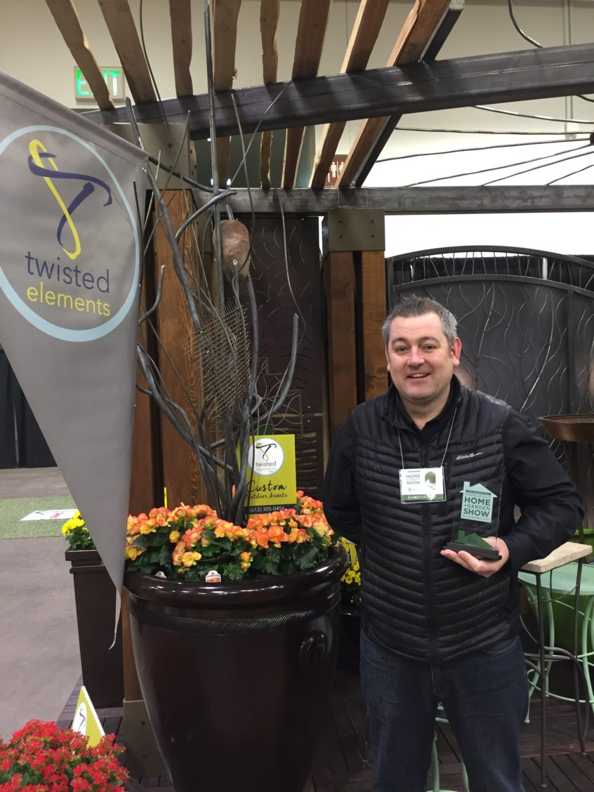 Peter McLoughlin with Twisted Elements Award for Best Booth at the Minneapolis Home and Garden Show 2017