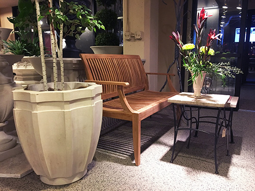Westminster Teak Bench, MetalSmith's Table, and Haddonstone Planter
