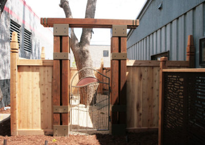 Custom Metal Gate and Cedar Arbor with OUTDECO Panels to Hide A/C
