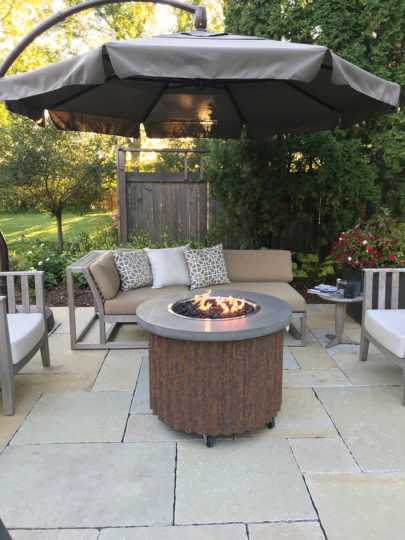 Metalsmiths-gas-fire-feature-surrounded-by-westminster-teak-maya-sectional