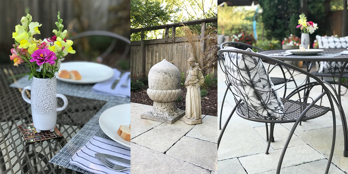 Metalsmiths-metal-table-and-chairs-with-a-haddonstone-cast-concrete-acorn-statuary