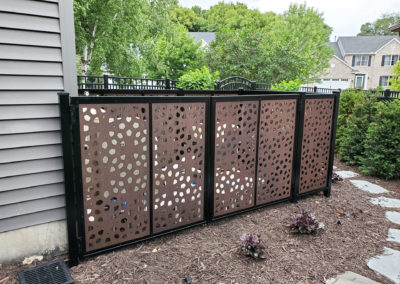 Outdeco Screens Around Pool Equipment Installed by Dakota Unlimited