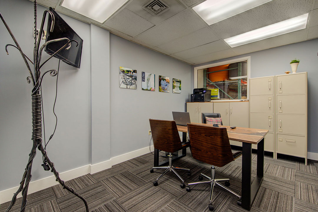 Twisted-elements-new-showroom-conference-room-in-eden-prairie-mn-with-river-table-and-metalsmiths-coat-rack-web