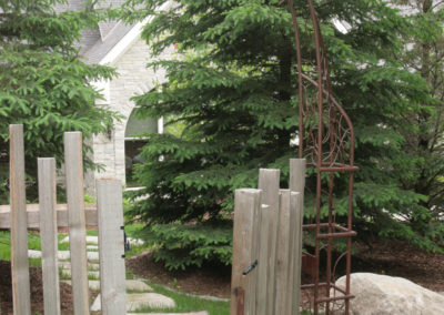 Cedar Fencing with Custom Twisted Metal Arbor by Metalsmith's Designs
