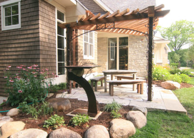 Courtyard with Custom Metal Work, Cedar Arbor and Water Feature by Metalsmith's Designs
